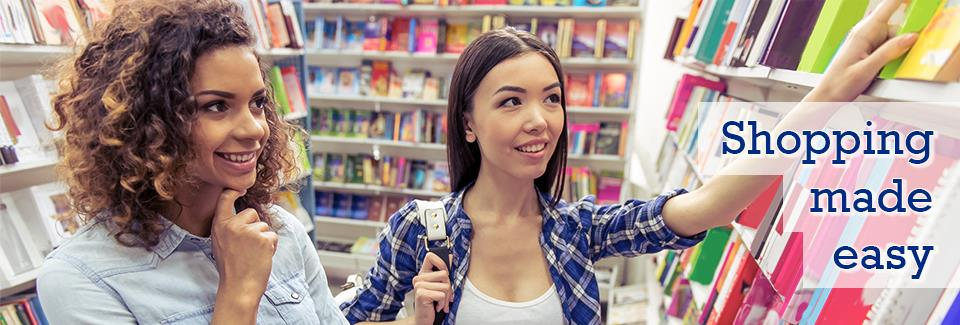 "Two female students smiling while shopping for books with the words ""Shopping made easy"" on the right of the slideshow banner."
